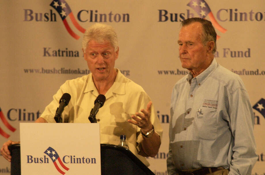 Former Presidents Bill Clinton, left, and George H.W. Bush during a press conference in Houston  before meeting with Hurricane Katrina evacuees, Monday, Sept. 5, 2005 (AP Photo/Chronicle/Carlos Rios) Photo: Carlos Rios, Staff / Houston Chronicle