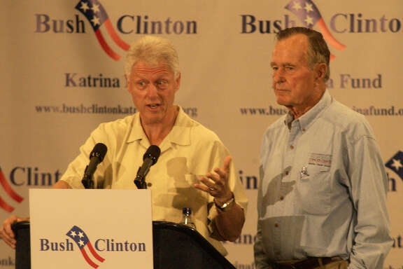Former Presidents Bill Clinton, left, and George H.W. Bush during a press conference in Houston  before meeting with Hurricane Katrina evacuees, Monday, Sept. 5, 2005 (AP Photo/Chronicle/Carlos Rios)
