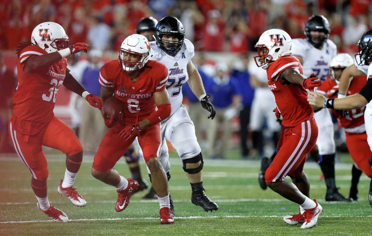 Houston Cougars linebacker Emeke Egbule (8) runs the ball back 24-yards for the touchdown after aTulsa fumble during the fourth quarter of an NCAA college football game at TDECU Stadium, Saturday, Oct. 15, 2016.