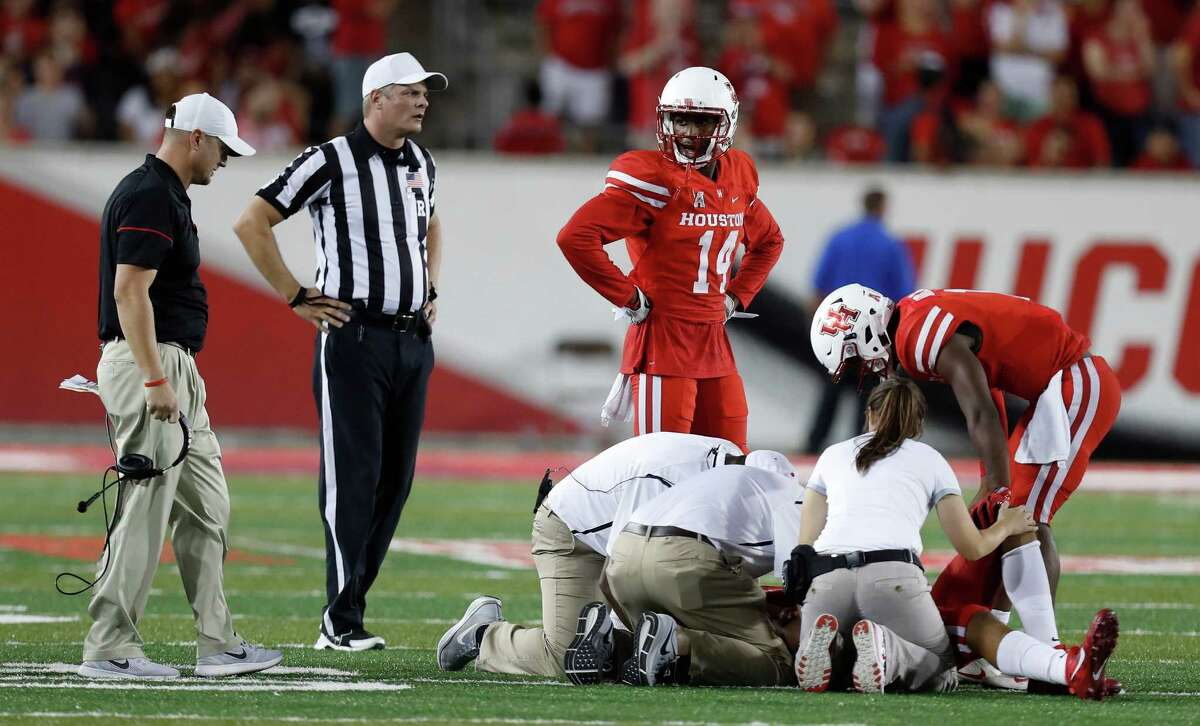 Houston Cougars quarterback Greg Ward Jr. (1) checks on wide receiver Chance Allen (21) who was injured during the second half of an NCAA college football game at TDECU Stadium, Saturday, Oct. 15, 2016.