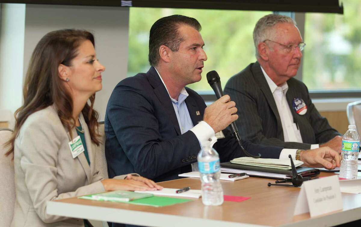 Board member Gordy Bunch, running for re-election for Position 1 with The Woodlands Township, speaks along side fellow candidates Amy Lampman, left, and Bob Leilich during a forum for candidates running for The Woodlands Township at Sam Houston State University - The Woodlands Center Thursday in The Woodlands.