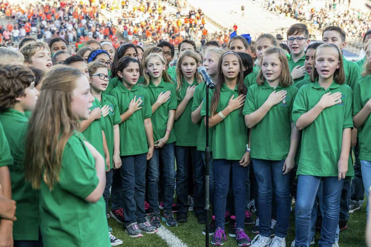 October 15 2016: Kilpatrick Elementary students sing the National Anthem during the NCAA football game between the UTSA Roadrunners and Rice Owls in Houston, Texas. (Leslie Plaza Johnson/Chronicle)