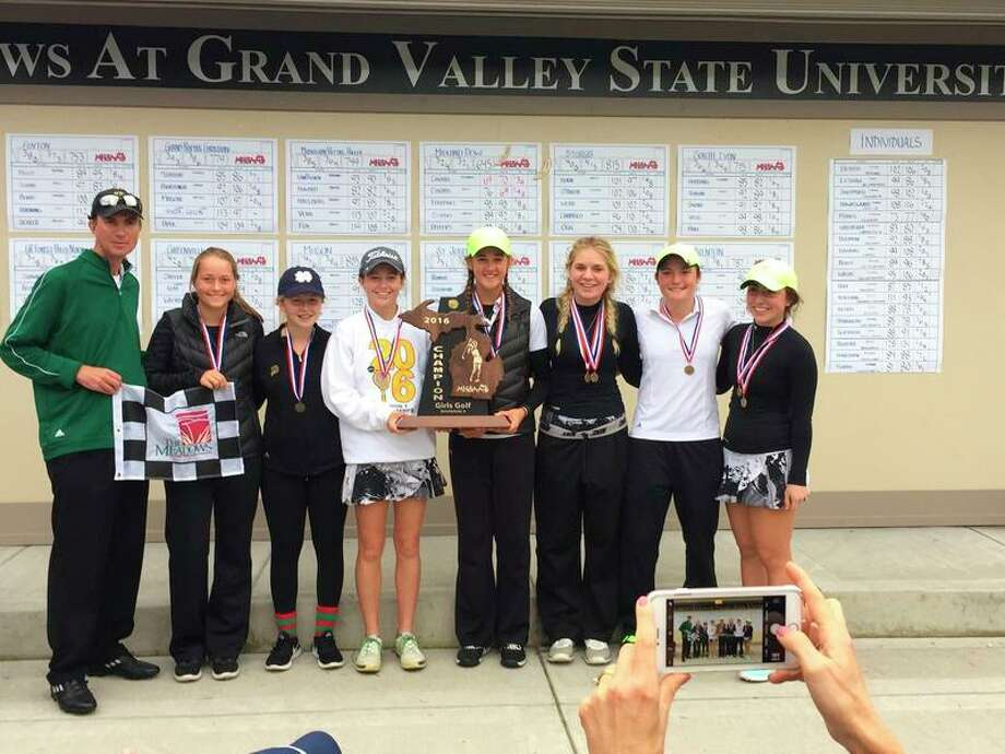 Photo provided by Doug Bradford The Dow High golf team celebrates its first state championship on Saturday: from left, coach Doug Bradford, Tatum Matthews, Grace Baillargeon, Mina Fabiano, Morgan Deiters, Alexis Carras, Caroline Szabo and Stephanie Carras.