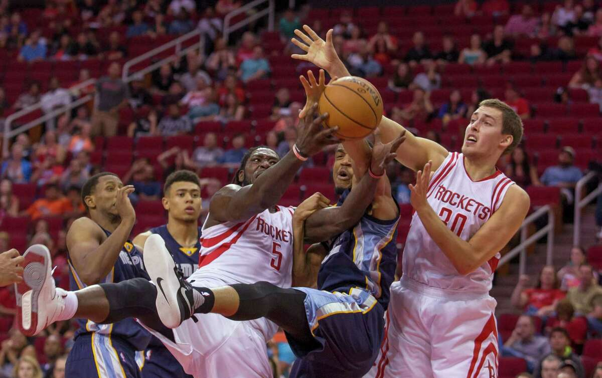 Houston Rockets forwards Montrezl Harrell and Kyle Wiltjer compete with Memphis Grizzlies forward Vince Hunter for a rebound during overtime of a preseason NBA basketball game Saturday, Oct. 15, 2016, in Houston. (AP Photo/Richard Carson)