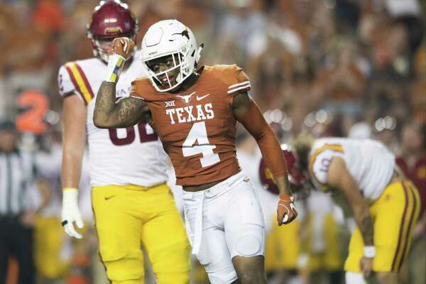 AUSTIN, TX - OCTOBER 15:  DeShon Elliott #4 of the Texas Longhorns celebrates after a defensive stop against the Iowa State Cyclones during the second half on October 15, 2016 at Darrell K Royal-Texas Memorial Stadium in Austin, Texas.