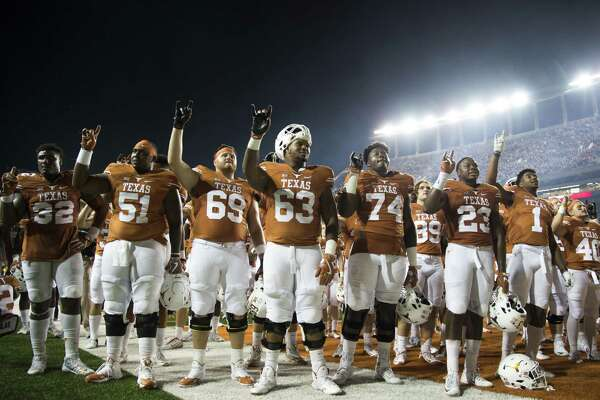 AUSTIN, TX - OCTOBER 15:  The Texas Longhorns celebrate after defeating the Iowa State Cyclones 27-6 on October 15, 2016 at Darrell K Royal-Texas Memorial Stadium in Austin, Texas.