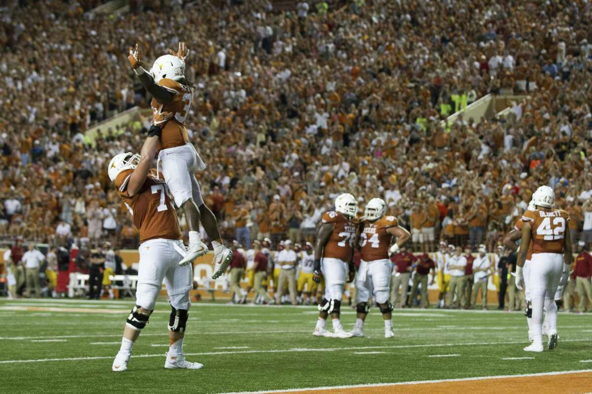 AUSTIN, TX - OCTOBER 15: D'Onta Foreman #33 of the Texas Longhorns celebrates after an 18 yard touchdown run against the Iowa State Cyclones during the second half on October 15, 2016 at Darrell K Royal-Texas Memorial Stadium in Austin, Texas.