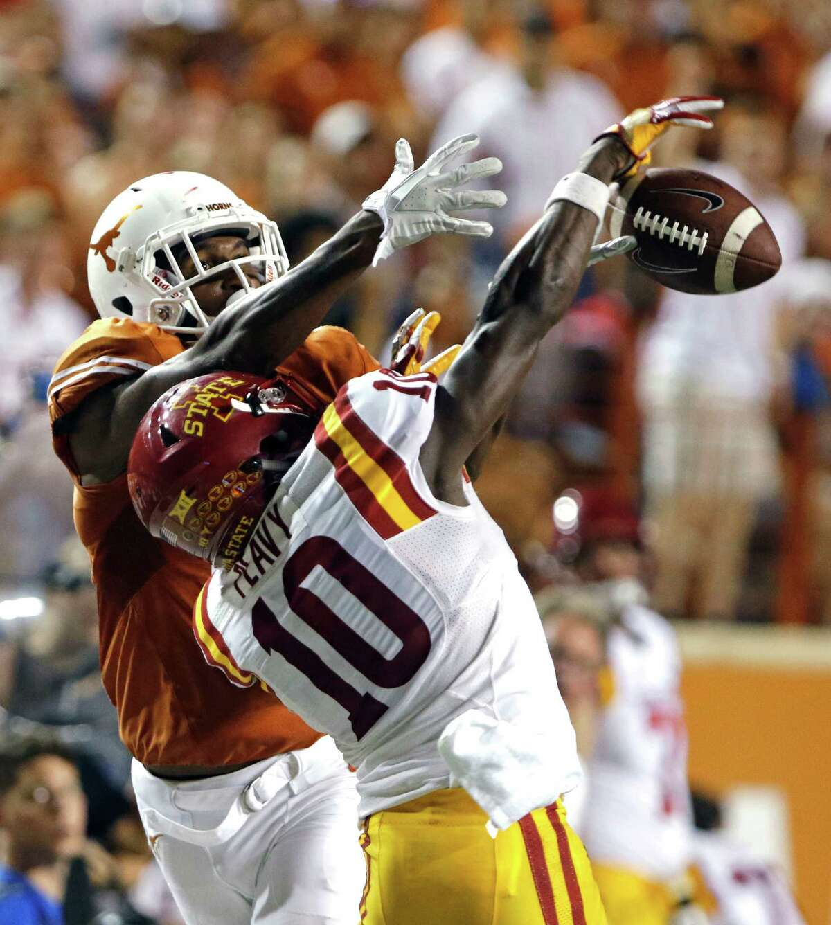 Texas receiver John Burt, left, goes up for a pass while defended by Iowa State's Brian Peavy, right, during the second half of an NCAA college football game, Saturday, Oct. 15, 2016, in Austin, Texas. (AP Photo/Michael Thomas)