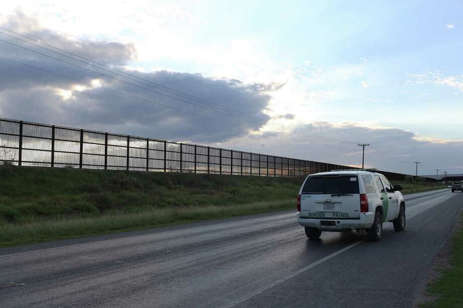 FILE — A U.S. Border Patrol unit makes its way along U.S. 281 by the U.S.-Mexico border wall near San Benito, Texas. According to a statement from U.S. Customs and Border Protection, an agent was struck by a bullet fired from the Mexican side of the Rio Grande River on Tuesday, Dec. 26, 2017, near Brownsville, Texas. Photo: JERRY LARA, Staff / San Antonio Express-News / © 2016 San Antonio Express-News