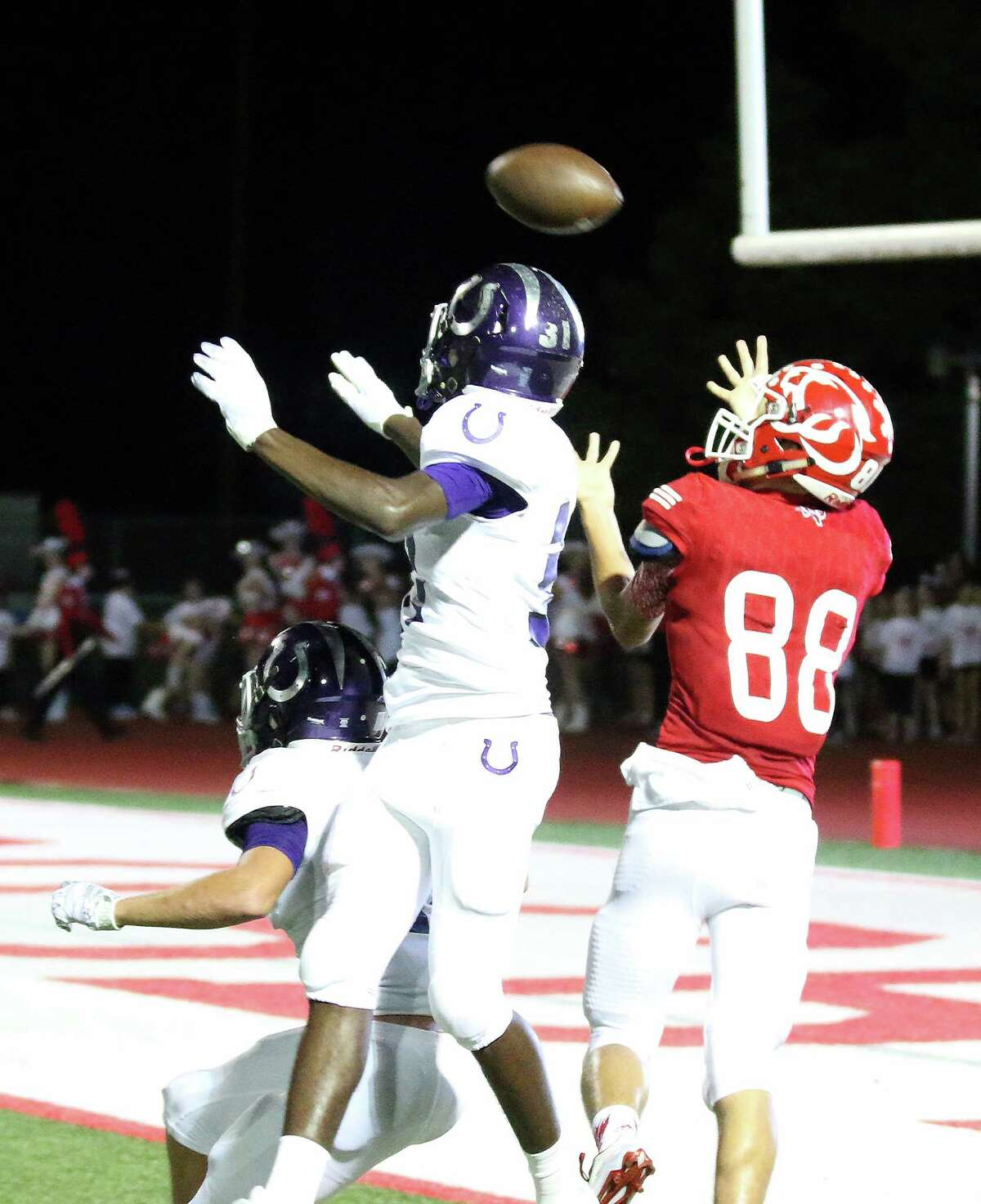 Crosby quarterback Mannie Netherly floats the pass over two Dayton defenders into the hands of Ronny Woodard for a Crosby TD. The Coogs had to come from behind to defeat the Broncos, 41-34 in OT.