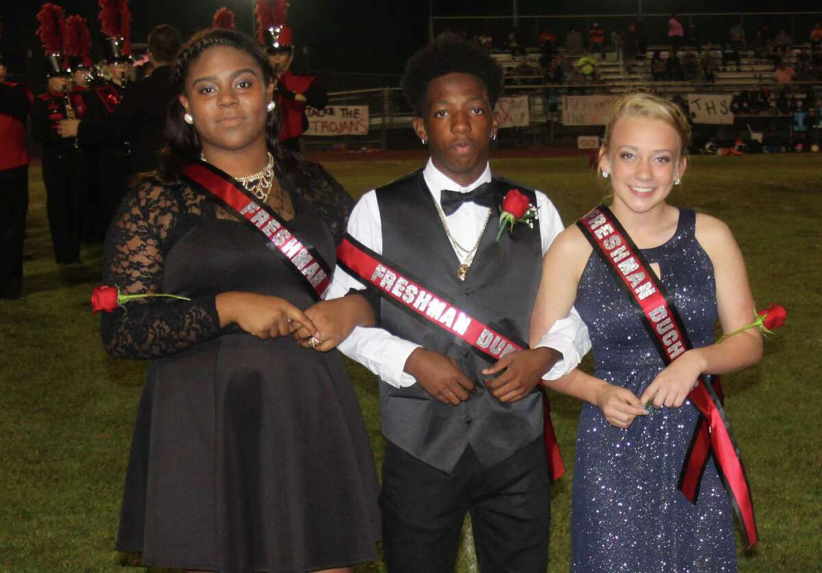The freshman court stands to the side of the field during the Trojan homecoming game. Pictured left to right are Tylia McGowen, Tadrean Rucker and Cheyenne Tyson.