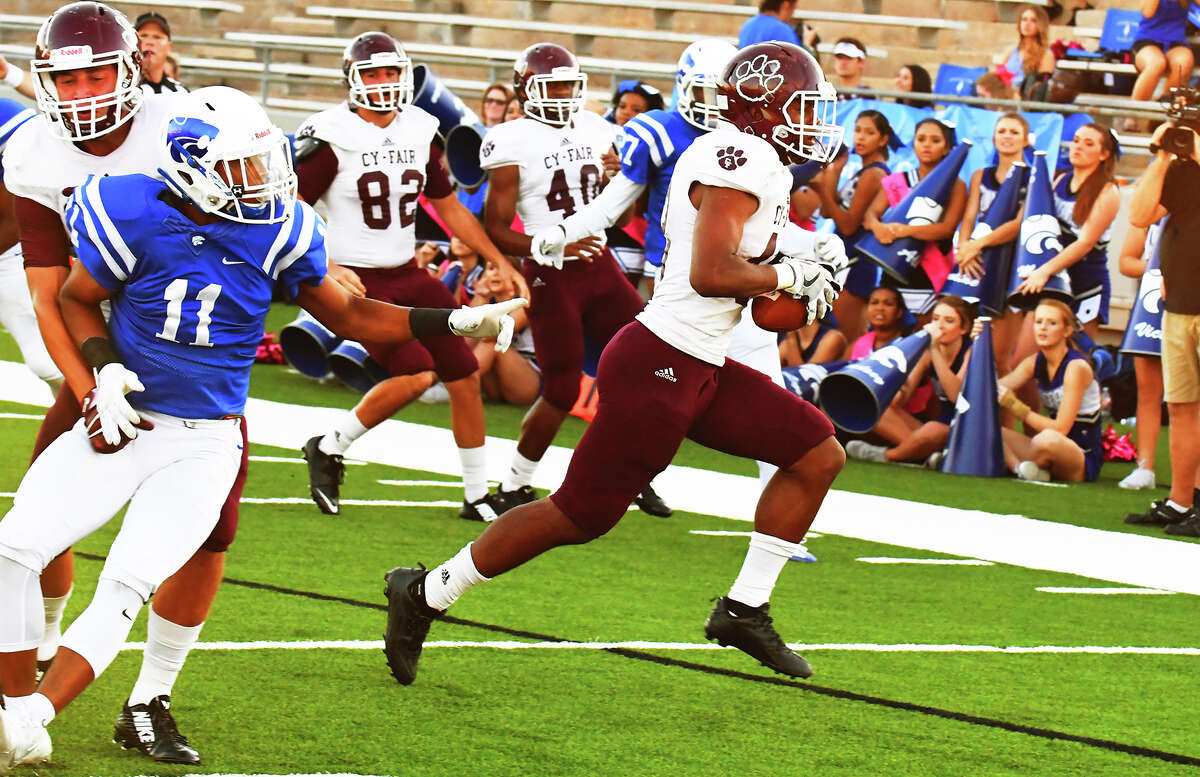 Cy-Fair junior rusher Trenton Kennedy rushes for a first down against Cy Creek Saturday night at Pridgeon Stadium. Kennedy finished as the game's leading rusher, racking up 170 yards and three touchdowns on 31 carries.