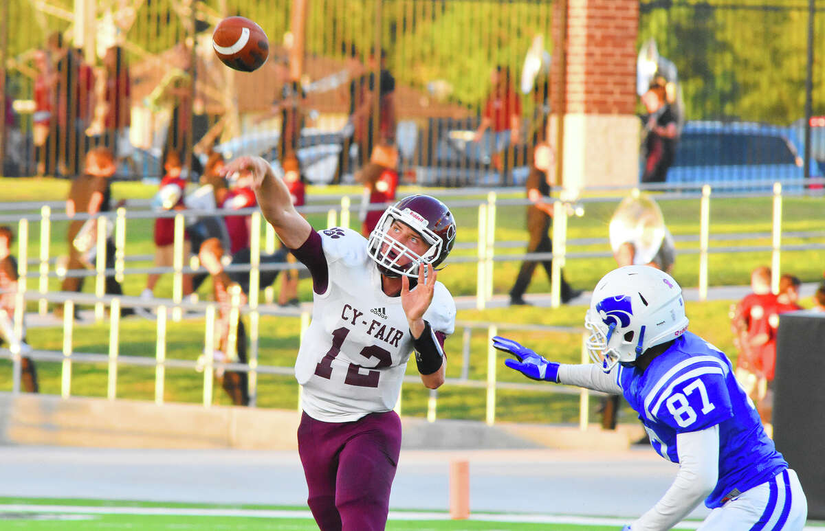 Cy-Fair junior quarterback Cam Arnold airs it out against Cy Creek Saturday night at Pridgeon Stadium. Arnold has been a consistently strong signal-caller for the Bobcats, and his 11-20-1 passing performance was enough to get the job done against the Cougars.