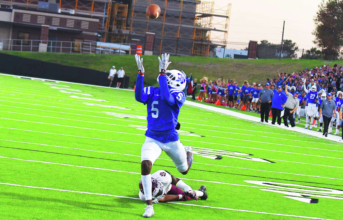 Cy Creek junior receiver Miles Battle reels in the first of his two touchdown receptions against Cy-Fair Saturday night. Battle has proven time and again to be one of the most potent offensive weapons in 17-6A, and he finished with 10 catches for 111 yards against Cy-Fair.
