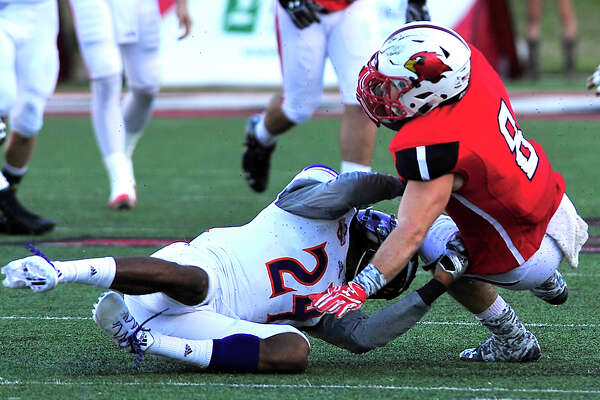 Lamar's Kade Harrington is brought down by Northwestern State's Ian Edwards during Saturday's home match-up at Provost-Umphrey Stadium. Photo taken Saturday, October 15, 2016 Kim Brent/The Enterprise