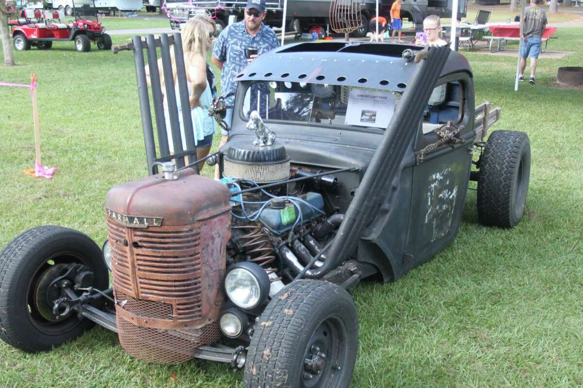 A family of four admire a 1939 Ford rat rod owned by Robby Koon at the Wolf Creek Car Show on Oct. 15.