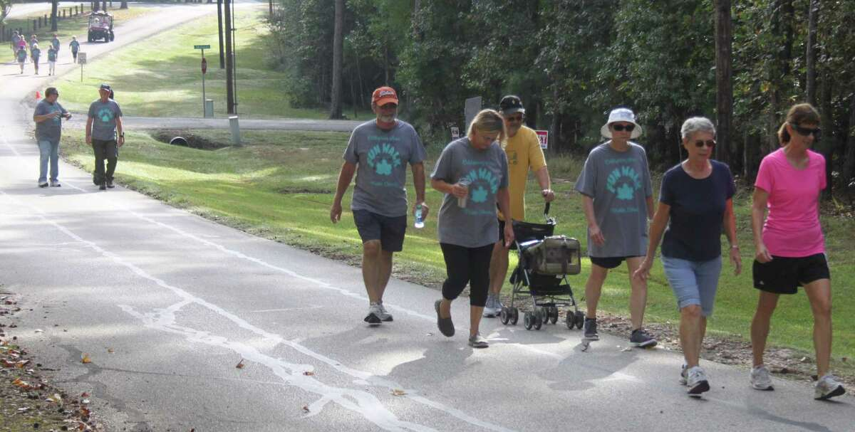 Three groups of walkers make their way back to the Cape Royale clubhouse to finish the Fun Walk on Oct. 15. The Cape Royale Fun Walk is an annual fundraiser for the Coldspring Area Public Library.