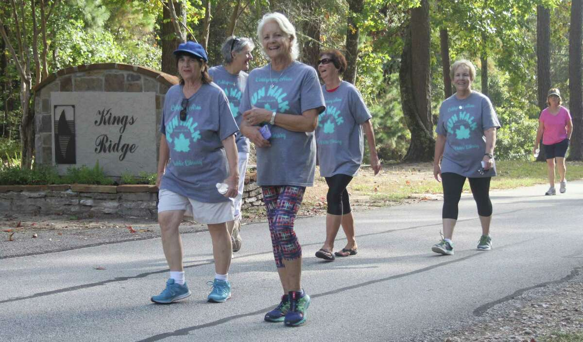 Participants in the Cape Royale Fun Walk enjoy each other's company as they return from King's Ridge.