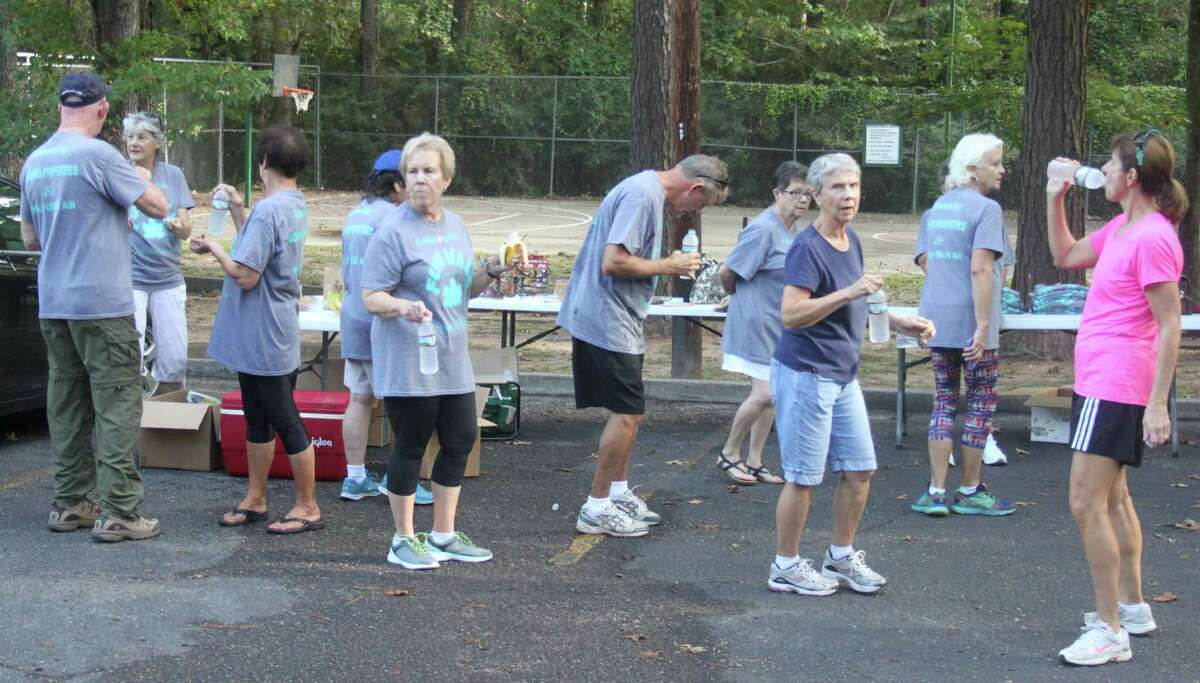The participants in the Cape Royale Fun Walk make their way back to the Cape Royale clubhouse parking lot and enjoy refreshments before receiving prizes.