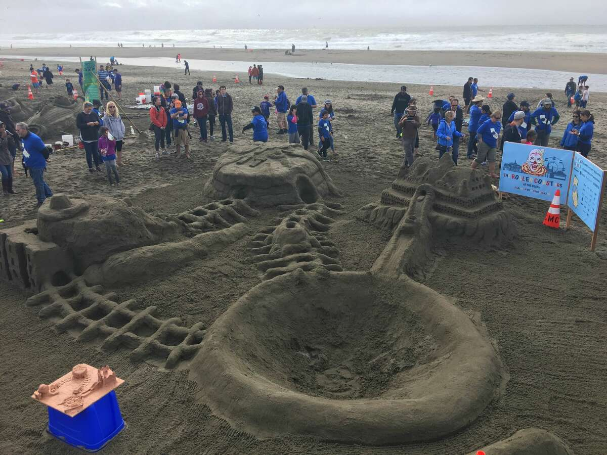 Groups from dozens of Bay Area schools compete in the annual Leap Sand Castle Contest on Saturday, Oct. 15, 2016. In this photo, Hillcrest School constructs the old Cliff House and Playland amusement park.