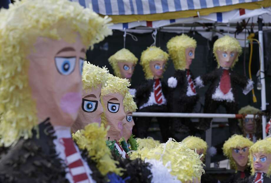 Piñatas in the likeness of GOP presidential candidate Donald Trump are sold in Elgin, Texas. Photo: Eric Gay, Associated Press