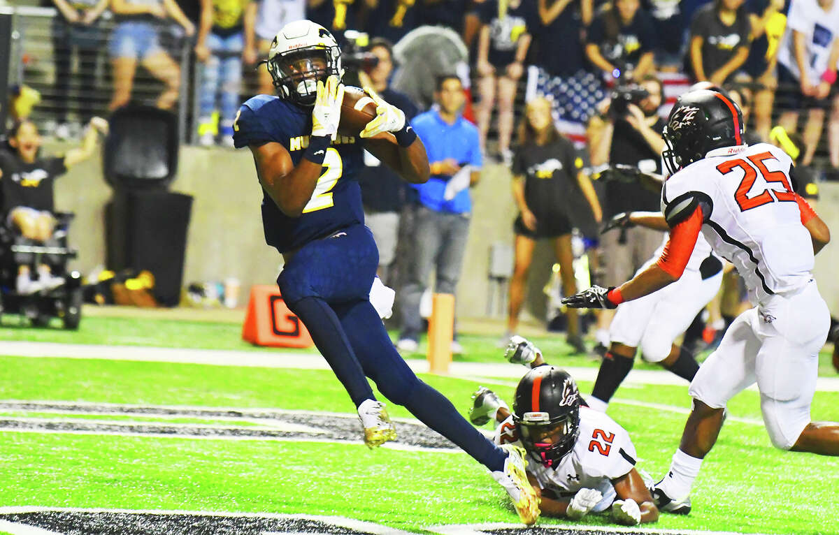 Cy Ranch senior wide receiver R.J. Sneed catches a touchdown against Langham Creek Friday at Cy-Fair FCU Stadium. Head coach Gene Johnson says that the Mustangs' receivers might only get one or two opportunities to make plays in a game, but that it is vital they maximize them.
