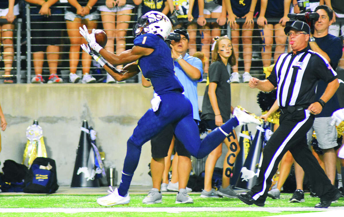 Cy Ranch senior wide receiver Keric Wheatfall reels in a 41-yard reception Friday night against Langham Creek. Like Sneed, Wheatfall's opportunities to make plays are limited in the Mustangs' run-heavy offense, but both wide outs have proven adept at making the most of their chances.