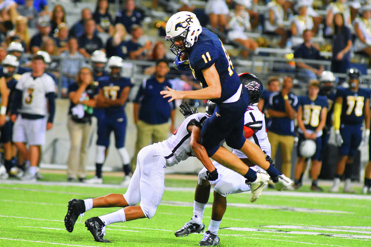 Cy Ranch senior quarterback Blake Nevins rushes for a first down against Langham Creek Friday night. Nevins enjoyed a strong outing against the Lobos, completing six of his eight pass attempts for 98 yards and rushing for 27 more on six attempts. Nevins still has yet to throw an interception this season.