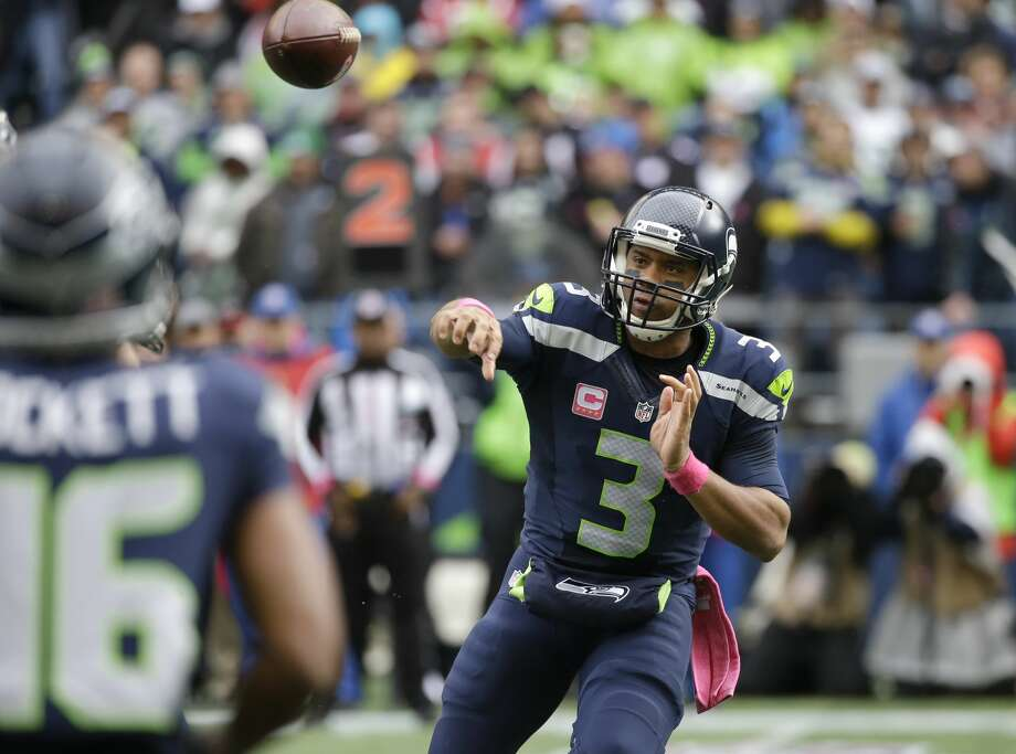 Quarterback: BIf we were grading on degree of difficulty, Russell Wilson would get an A after dealing with serious ankle and knee injuries that limited his trademark mobility for much of the season. But since we're not grading on a curve, Wilson gets a B. Despite setting career and franchise highs for passing yards with 4,219, the fifth-year pro's touchdowns were down and his interceptions were up. Certainly not all of the blame goes to Wilson, but he has seemed to struggle with accuracy much more this season than in recent memory. Wilson also set a career low with 259 rushing yards, which makes sense given his injuries. Photo: Elaine Thompson/AP