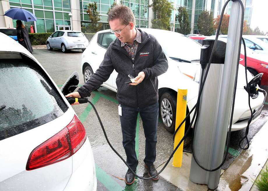 Informatica vice president Bill Burns disengages the plug after receiving a message from Waitlist that his car is fully charged on Friday, October 14, 2016, in Redwood City, Calif. Photo: Liz Hafalia, The Chronicle