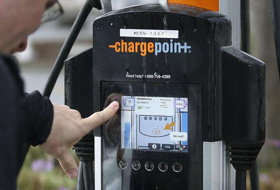 Informatica vice president Bill Burns shows how he works with Waitlist, an app for electric car drivers letting users know when their cars are charged and when a station is open  on Friday, October 14, 2016, in Redwood City, Calif. Photo: Liz Hafalia, The Chronicle