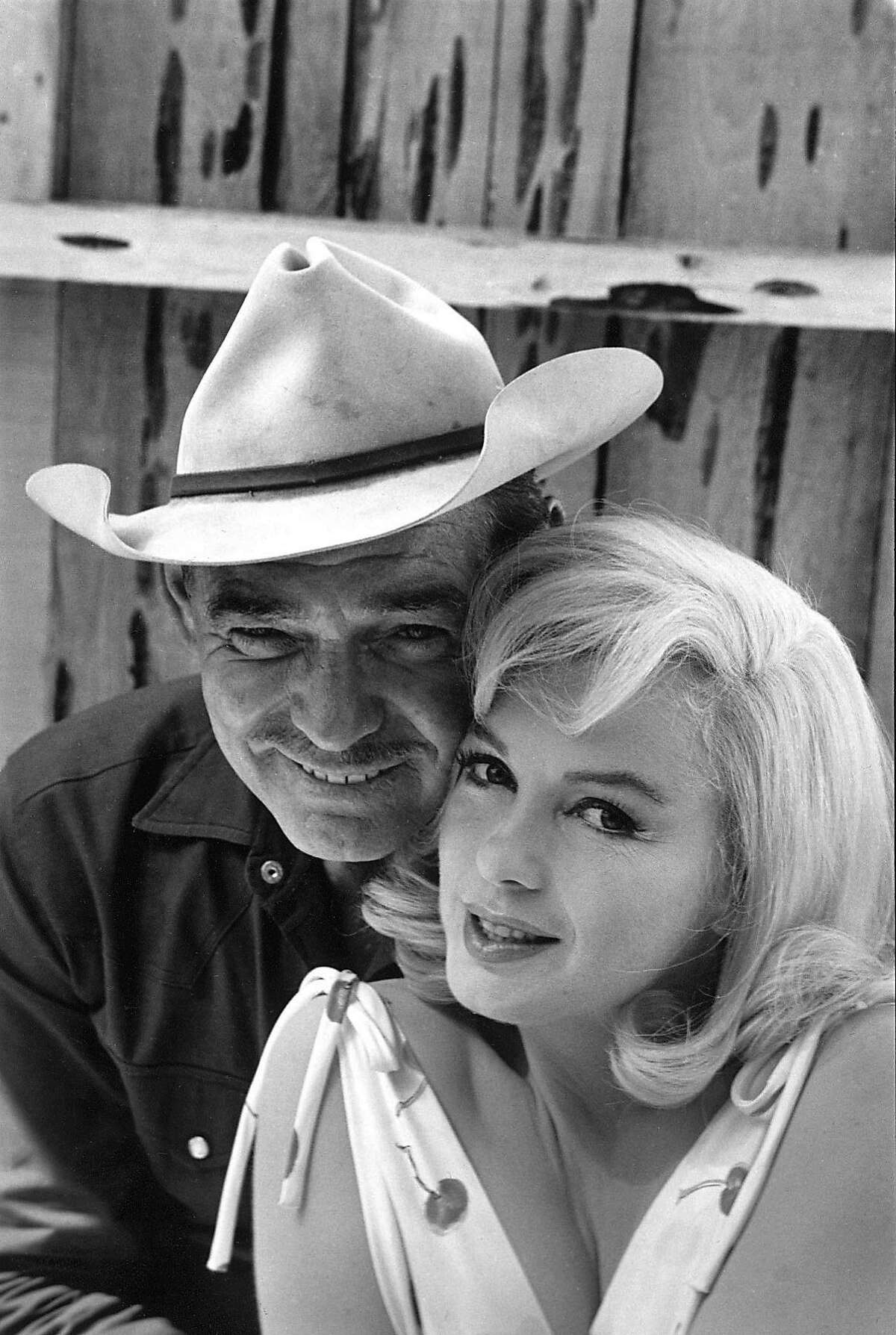 """THIS IS A HANDOUT IMAGE. PLEASE VERIFY RIGHTS. MISFITS30-B-27SEP02-DD-HO The fabled film was the final work of two Hollywood icons, Clark Gable and Marilyn Monroe (pictured), directed by John Huston. Making """"The Misfits"""" @ Photographer: Elliott Erwitt / Magnum Photos Ran on: 02-18-2005 Clark Gable and Marilyn Monroe in The Misfits. Ran on: 06-01-2006 Marilyn Monroe with Clark Gable in The Misfits (1961), written by Arthur Miller, her third husband. It was her second-to-last film. Ran on: 10-10-2010 Clark Gable and Marilyn Monroe starred in The Misfits."""