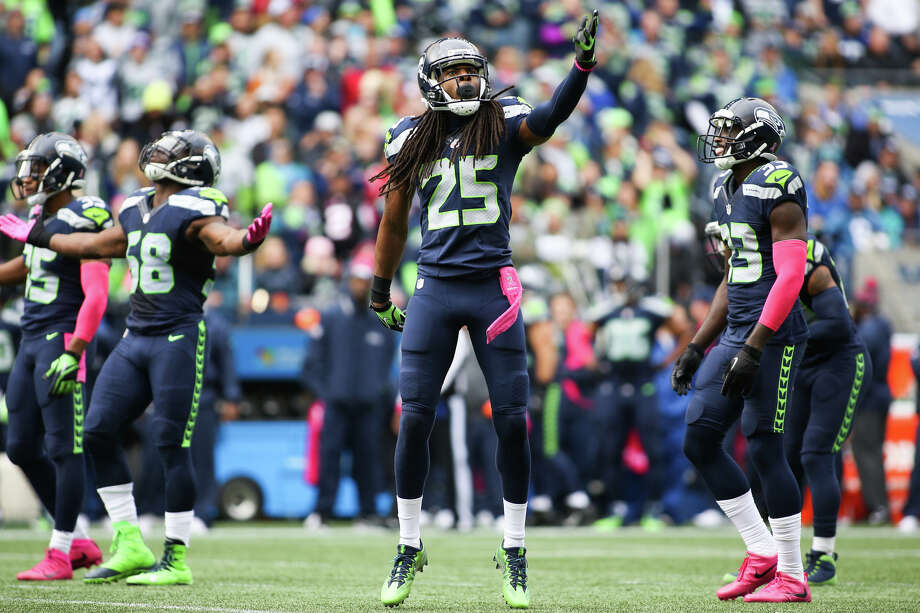 Seahawks cornerback Richard Sherman gets hyped with the rest of the Legion of Boom in the second quarter against the Atlanta Falcons at CenturyLink Field, Sunday, Oct. 16, 2016. Photo: GRANT HINDSLEY, SEATTLEPI.COM / SEATTLEPI.COM