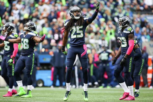 Seahawks corner back Richard Sherman gets hyped with the rest of the Legion of Boom in the second quarter against the Atlanta Falcons at CenturyLink Field, Sunday, Oct. 16, 2016.