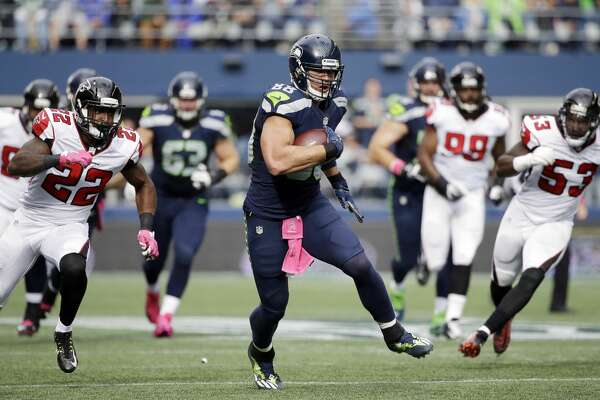 Seattle Seahawks tight end Jimmy Graham runs the ball after a reception against the Atlanta Falcons in the first half of an NFL football game, Sunday, Oct. 16, 2016, in Seattle. (AP Photo/Elaine Thompson)