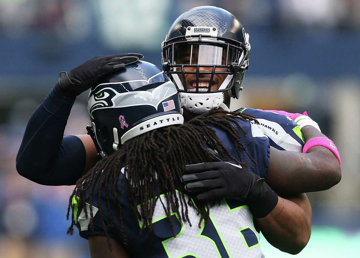 Seahawks linebacker Bobby Wagner hugs Seahawks running back Alex Collins after Collins scored a touchdown in the second quarter of Seattle's game against Atlanta, Sunday Oct. 16, 2016, at CenturyLink Field. (Genna Martin, seattlepi.com)