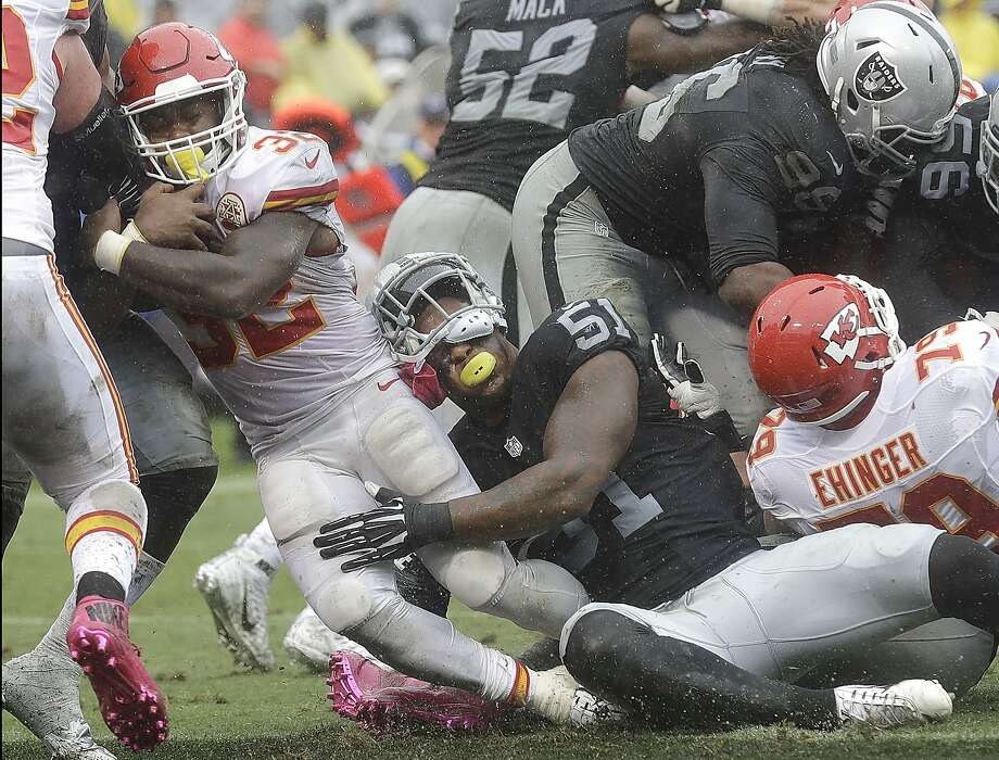 Oakland linebacker Bruce Irvin (51) can't stop Kansas City running back Spencer Ware from scoring Sunday. The Raiders have the NFL's 32nd-ranked defense. The 49ers, who lost NaVorro Bowman (53), below, are 27th. Photo: Marcio Jose Sanchez, Associated Press