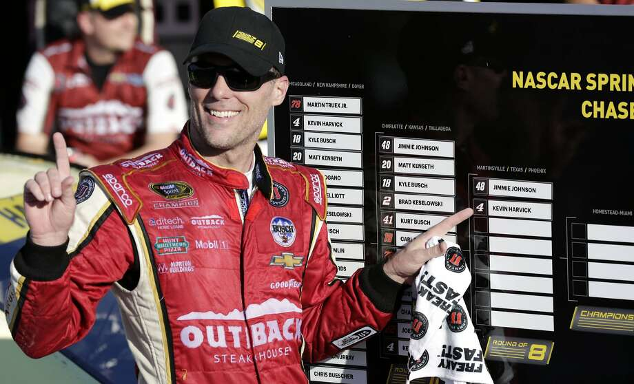 Kevin Harvick points to the Sprint Cup Chase scoreboard. He and Jimmie Johnson are the only two drivers sure to advance. Photo: Colin E. Braley, Associated Press