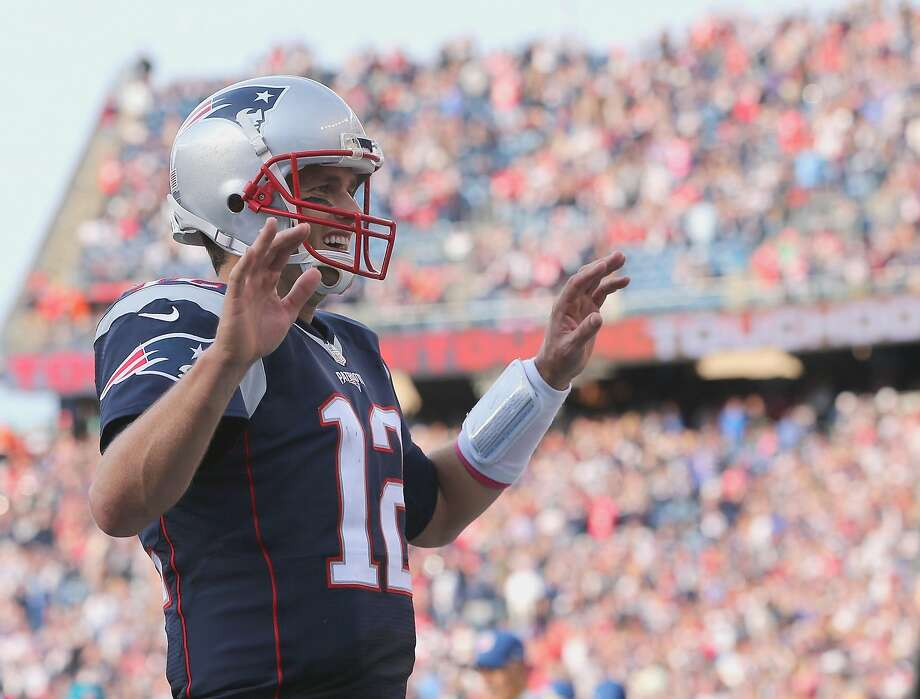 Tom Brady celebrates one of his three touchdown passes in his return to Foxborough after serving a four-game suspension. Photo: Jim Rogash, Getty Images