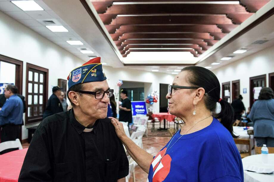 Army veteran Father Richard Peña, left, and Choco Meza, a community organizer for San Antonio for Hillary, Kaine, talk together at a Veterans for Hillary rally put on by San Antonio for Hillary, Kaine, and by the Bexar County Democratic Party on Friday, September 2, 2016. Photo: Matthew Busch / For The San Antonio Express-News / © Matthew Busch