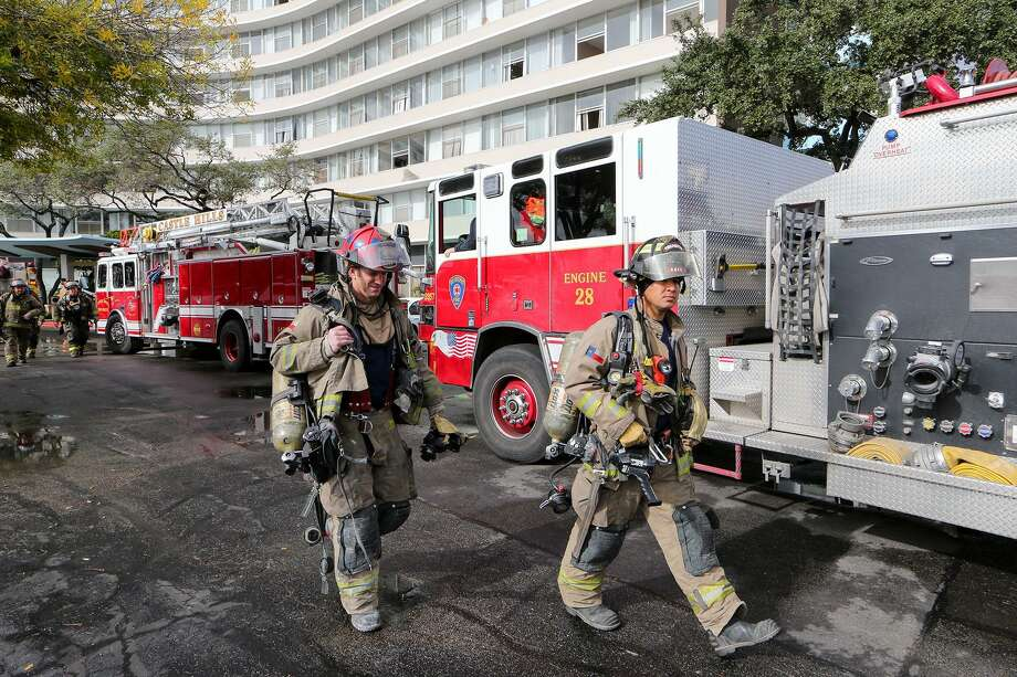 Firefighters and emergency units prepare to leave from a three-alarm fire at the Wedgewood Senior Apartments, 6701 Blanco Rd., on Sunday, Dec. 28, 2014. The early morning fire, which started shortly after 6:00 a.m., claimed the lives of five people. Three others were taken to the hospital and approximately 75-100 residents were evacuated to Churchill High School. Photo: Marvin Pfeiffer /San Antonio Express-News / Express-News 2014