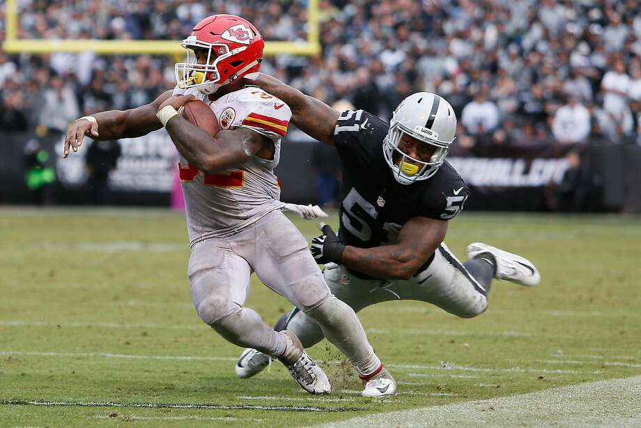 OAKLAND, CA - OCTOBER 16:  Spencer Ware #32 of the Kansas City Chiefs breaks a tackle by Bruce Irvin #51 of the Oakland Raiders during their NFL game at Oakland-Alameda County Coliseum on October 16, 2016 in Oakland, California.  (Photo by Brian Bahr/Getty Images) Photo: Brian Bahr, Getty Images