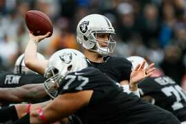 OAKLAND, CA - OCTOBER 16:  Derek Carr #4 of the Oakland Raiders looks to pass against the Kansas City Chiefs during their NFL game at Oakland-Alameda County Coliseum on October 16, 2016 in Oakland, California.  (Photo by Brian Bahr/Getty Images)