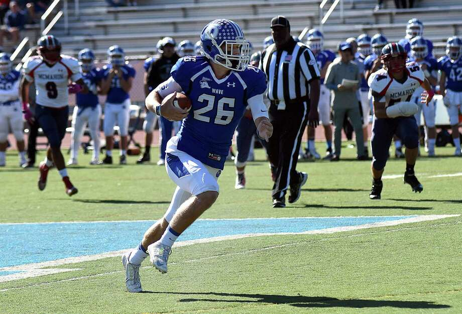 Darien's Nick Green heads up field on a 51-yard pass play in the first quarter of Saturday's FCIAC football game against Darien. The host Blue Wave won 54-17. Photo: John Nash / Hearst Connecticut Media / Norwalk Hour