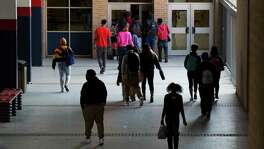 Students of Kashmere High School walk the school as they exchange classrooms on March 6, 2015, in Houston. (File photo)