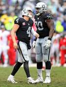 Oakland Raiders' Derek Carr walks off the field after fumbling in 4th quarter of 26-10 loss to Kansas City Chiefs during NFL game at Oakland Coliseum in Oakland, Calif., on Sunday, October 16, 2016.