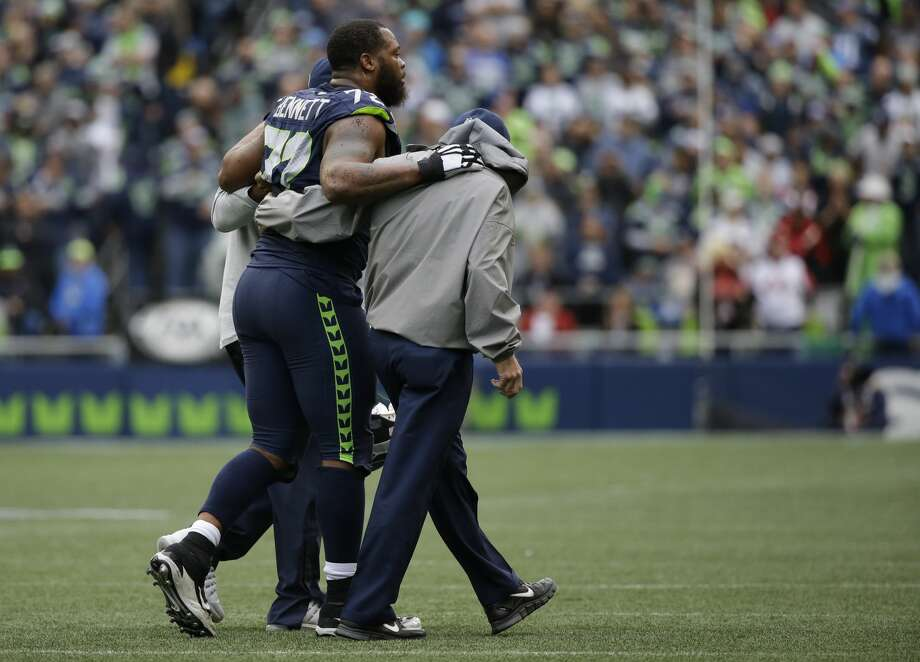 Seattle Seahawks defensive end Michael Bennett leaves the field with an injury in the second half of an NFL football game against the Atlanta Falcons, Sunday, Oct. 16, 2016, in Seattle. (AP Photo/Elaine Thompson) Photo: Elaine Thompson/AP