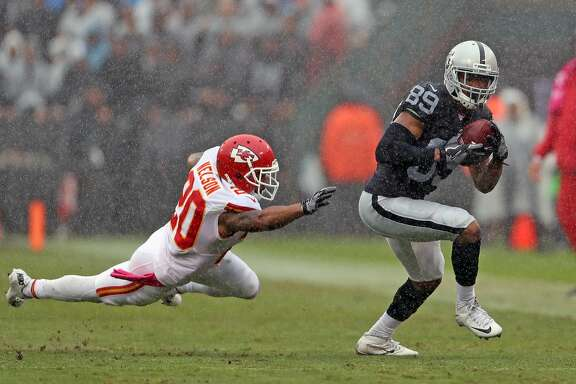 Oakland Raiders' Amari Copper runs after a 2nd quarter catch as Kansas City Chiefs' Steven Nelson fails to make the tackle during Raiders' 26-10 loss during NFL game at Oakland Coliseum in Oakland, Calif., on Sunday, October 16, 2016.
