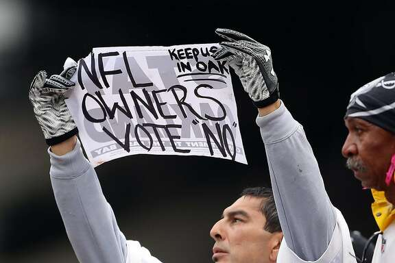 An Oakland Raiders' fan pleads for NFL owners to vote against move to Las Vegas during raiders 26-10 loss to Kansas City Chiefs during NFL game at Oakland Coliseum in Oakland, Calif., on Sunday, October 16, 2016.