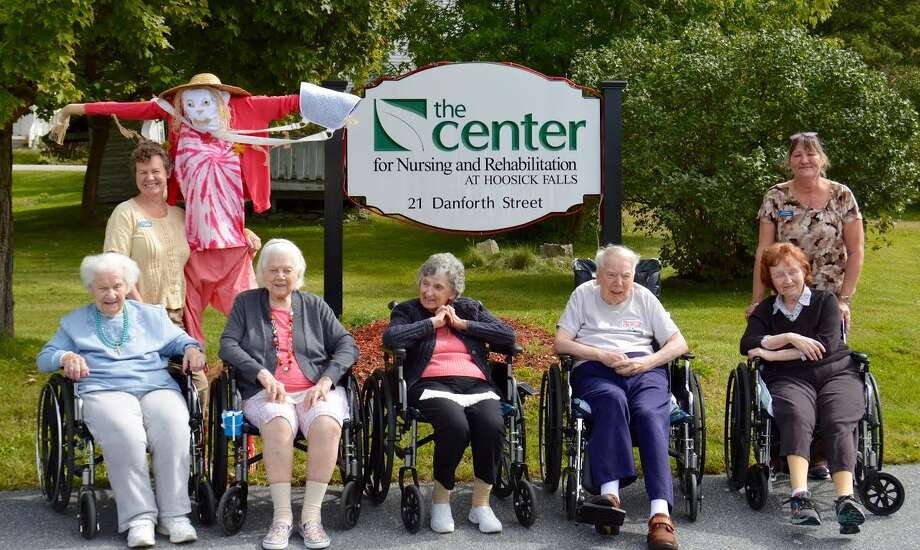 Residents at the Center for Nursing and Rehabilitation at Hoosick Falls celebrated the beginning of fall by taking part in the Hoosick Hullaballo ?Adopt a Scarecrow? Project! They created Mrs. Allus Fixedup at the center who now resides at Moses Farm stand in Eagle Bridge. Pictured, bottom row, from left, are: Anne Yurewitch, Martha Baker, Barbara Pierce, John Glover, and Cheryl Bissonnette. Top row, from left: Christa Caron, Mrs. Allus Fixedup, and Dianne Bryer.